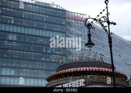 Traditional Cafe Kranzler on Kurfuerstendamm in Berlin, now surrounded by buildings with glass facades, Berlin, - Stock Photo