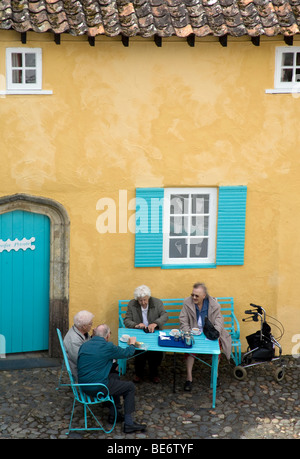 Elderly people taking tea in Batter Square, Portmeirion Wales UK - Stock Photo