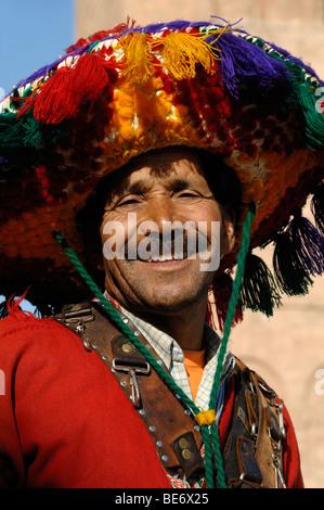 Smiling Water Seller Moroccan Man in Traditional Costume Djemma El Fna or El-Fna Square Marrakesh Morocco - Stock Photo