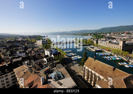 View from one of the towers of Grossmuenster, Great Minster Church, over the Limmat River, Quaibruecke bridge and - Stock Photo