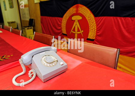 Telephone and GDR-flag in the Bunkermuseum museum Frauenwald, Thuringia, Germany, Europe - Stock Photo