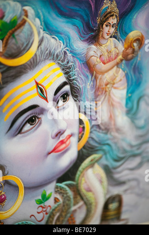 Lord Shiva and indian goddess on a hindu poster. India - Stock Photo