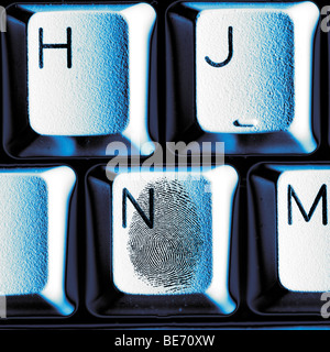 fingerprint on keyboard key illustrating identity theft - Stock Photo