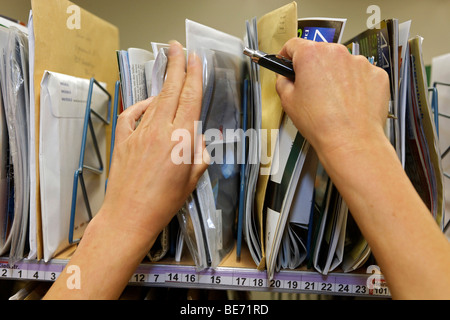 Mail carrier Annerose Schulze sorts her mail in the postal distribution center of the Deutsche Post AG German Mail - Stock Photo