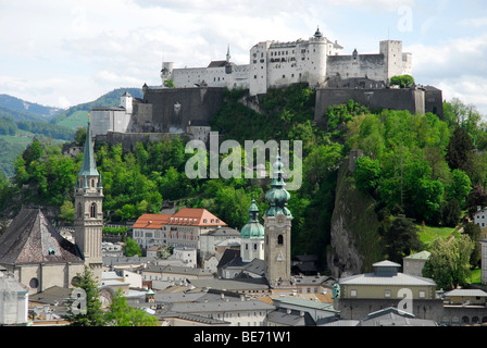 View from the Moenchsberg mountain on the old town with the Franziskanerkirche Franciscan church, and collegiate - Stock Photo