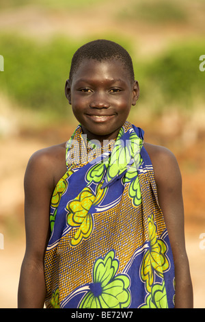 Portrait of Ugandan child in a village in Kabwoya wildlife reserve on the shores of Lake Albert in Uganda. - Stock Photo