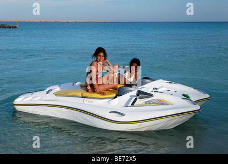 Egyptian girls on glass bottom boat with electric motor, Beach Mahmya, beach, Giftun Island, Hurghada, Egypt, Africa, - Stock Photo