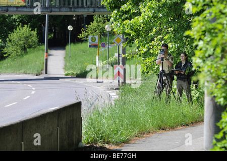 Police officers measuring speed with a laser gun, RIEGEL FG21-P, Stuttgart, Baden-Wuerttemberg, Germany, Europe - Stock Photo