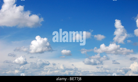 Blue sky with fluffy clouds in sunshine day, panoramic picture - Stock Photo