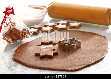 Cutting out cinnamon cookies, baking - Stock Photo