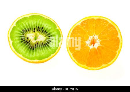 Orange filled with a Kiwi, symbolic image for genetic engineering - Stock Photo