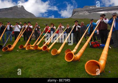 Alphorn blowers at the shepherd festival on Gemmi, Leukerbad, Loeche-les-Bains, Valais, Switzerland - Stock Photo