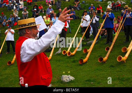 Conductor of a group of Alphorn blowers at the shepherd festival on Gemmi, Leukerbad, Loeche-les-Bains, Valais, - Stock Photo