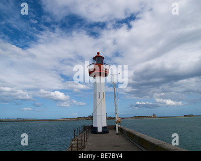 Small lighthouse in the port of St. Vaast la Hougue, Normandy, France with Ile de Tatihou in the background - Stock Photo