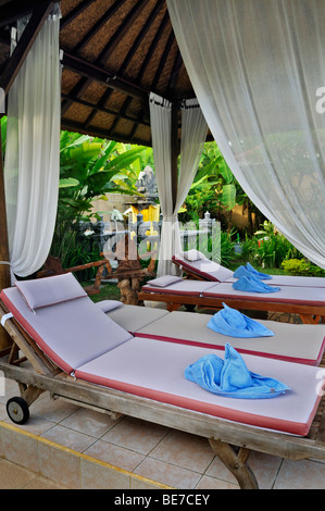 Pool loungers, bungalow complex of Jupp Palling near Denpasar, Bali, Indonesia, Southeast Asia - Stock Photo