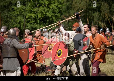 Viking warriors doing battle at a viking re-enactment festival in Denmark - Stock Photo