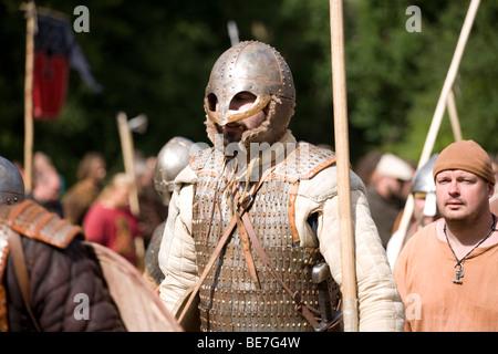 Viking warriors returning from battle at a viking re-enactment festival in Denmark - Stock Photo