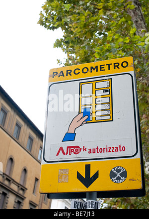 A battered parking meter (Parcometro) sign in Rome, Italy - Stock Photo