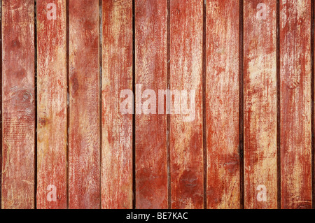 Old wood planks with red paint aligned together - Stock Photo