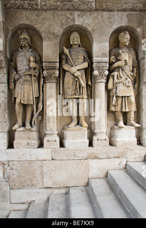 Statues guard rthe steps leading down from the Fishermen's Bastion, a famous monument in the old Buda area of Budapest - Stock Photo