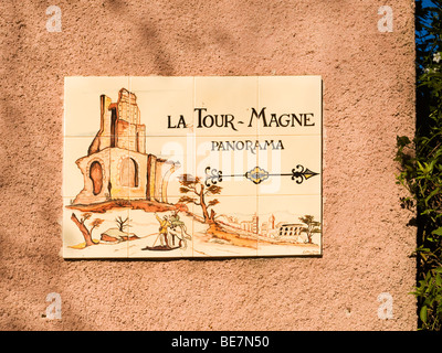 Tile sign on a wall near la Tour Magne, 'the Great Tower', a ruined Roman tower on Mont Cavalier, city of Nîmes, - Stock Photo