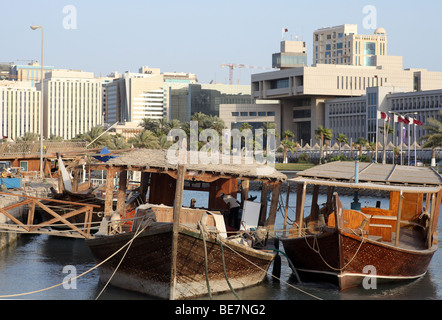 Working dhows moored at the harbour on Doha's Corniche, in Qatar, Arabia. In the background are buildings  from - Stock Photo