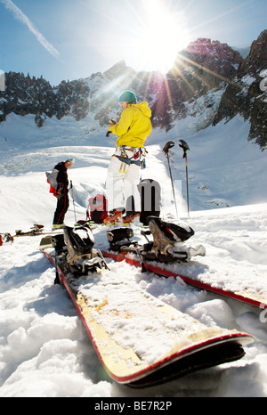 Skier adjusting alpine touring ski boots and wearing a for Salle a manger vallee blanche