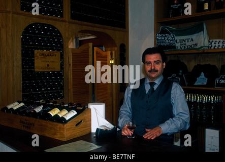 Portuguese man, server, tasting room, Graham's port house, Vila Nova de Gai,a Porto District, Portugal, Europe - Stock Photo