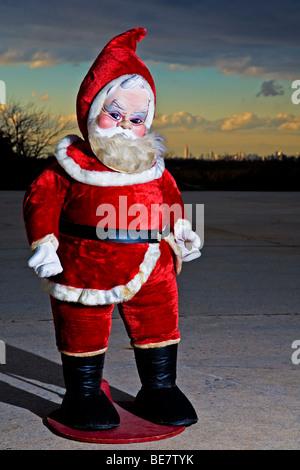 Kitsch Santa Claus in front of the Manhattan skyline.