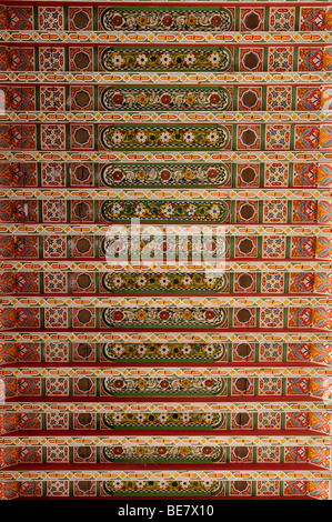 Morocco; Marrakech; Bahia Palace; Detail of Colourful Painted wooden Ceiling - Stock Photo