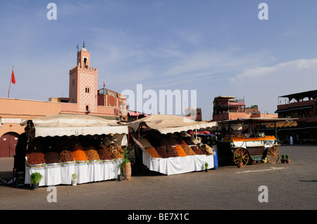 Dried Fruit and Orange Juice Stalls on Place Djemma el Fna, Marrakech, Morocco - Stock Photo