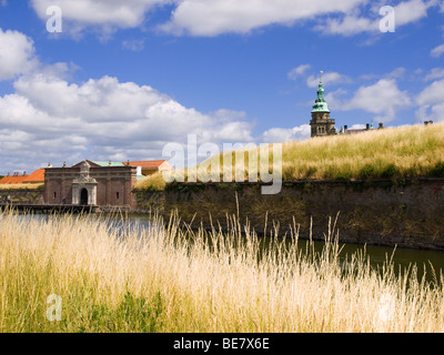 Looking at Kronborg Castle from outside the moat in Helsingør, Denmark. - Stock Photo