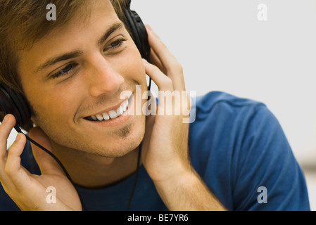 Young man listening to headphones - Stock Photo