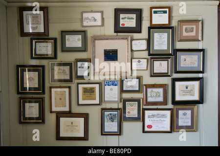 Decoration, photo frames with wine labels hung on the wall, Restaurant Taverne Zum Schaefli, Owner and head chef - Stock Photo