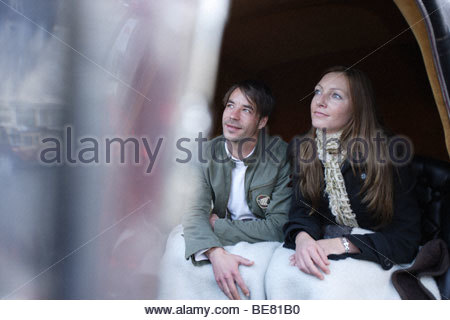 Young couple in a horse drawn carriage, town hall, market square, Weimar, Thuringia, Germany - Stock Photo