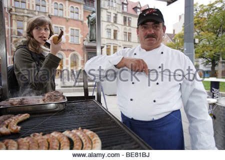 Die Thueringer Bratwursthexe at the Luther memorial, original Thuringian fried sausage on a charcoal grill, Erfurt, - Stock Photo