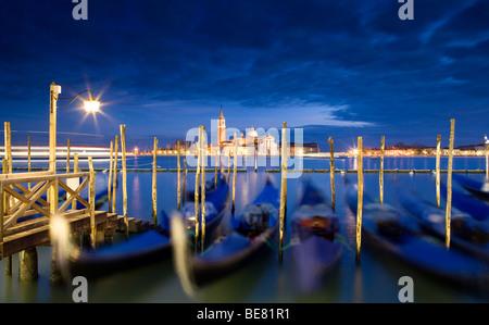 Quay at St Mark's Square with Gondolas and view towards San Giorgio Maggiore Island, Venice, Italy, Europe - Stock Photo