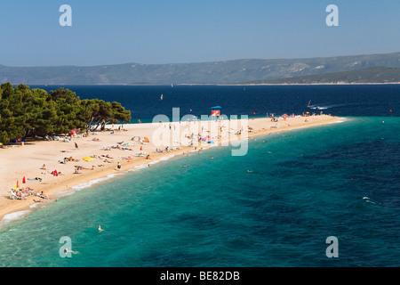 People at the beach in the sunlight, Golden Horn, Bol, Brac Island, Dalmatia, Croatia, Europe - Stock Photo