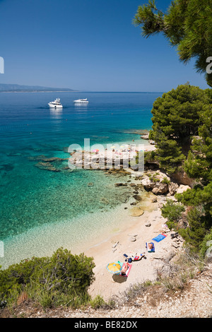 People at the beach in a little bay, Brac Island, Dalmatia, Croatia, Europe - Stock Photo