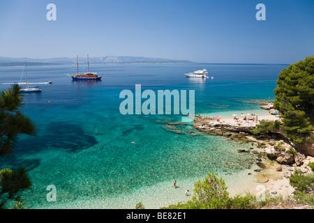 Beach and boats in a little bay, Brac Island, Dalmatia, Croatia, Europe - Stock Photo