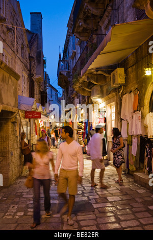 Tourists strolling though an alley at the Old Town of Hvar, Hvar Island, Dalmatia, Croatia, Europe - Stock Photo