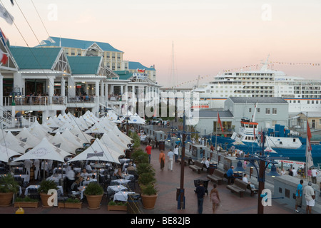 Waterfront Restaurants and Cruiseship MS Europa at Dusk, Cape Town, Western Cape, South Africa, Africa - Stock Photo