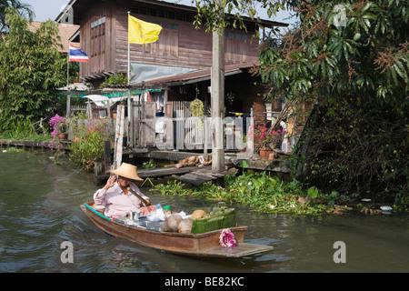 Thailand; Bangkok; A longtail boat on the Chao Phraya ...