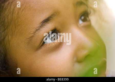 Little girl looking up, close-up - Stock Photo