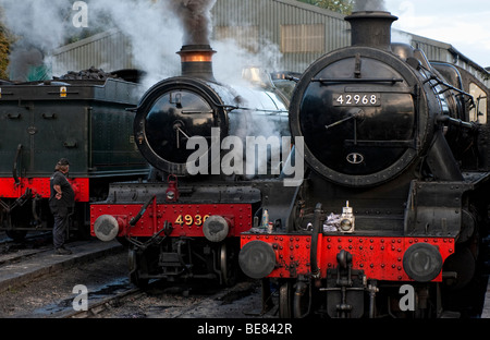 Steam locomotives being prepared in the sidings at Brignorth Railway Station on the Severn Valley Railway - Stock Photo