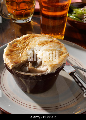... Inidual chicken pie with runner beans and beer in a table setting - Stock Photo & Inidual chicken pie with runner beans and beer in a table setting ...