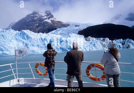 Tourists on a boat at the Upsala Glacier , Lago  Argentino, Parque  Nacional Los Glaciares, Patagonia, Argentina. - Stock Photo