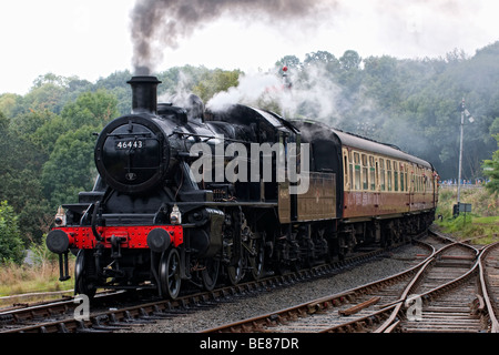 Steam locomotive approaching Highley Station on the Severn Valley Railway - Stock Photo