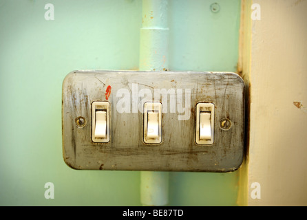 AN OLD LIGHT SWITCH IN A SCHOOL UK - Stock Photo