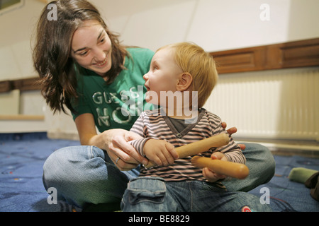 Mothers and children in baby center playing music. Baby music. - Stock Photo